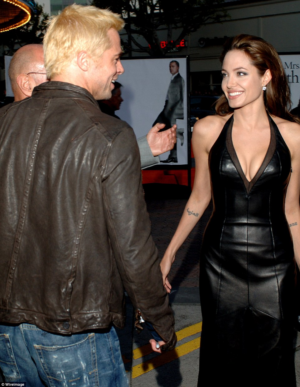 No longer hiding their romance: The pair's relationship was confirmed in April 2005, two months before Mr. & Mrs. Smith hit cinemas