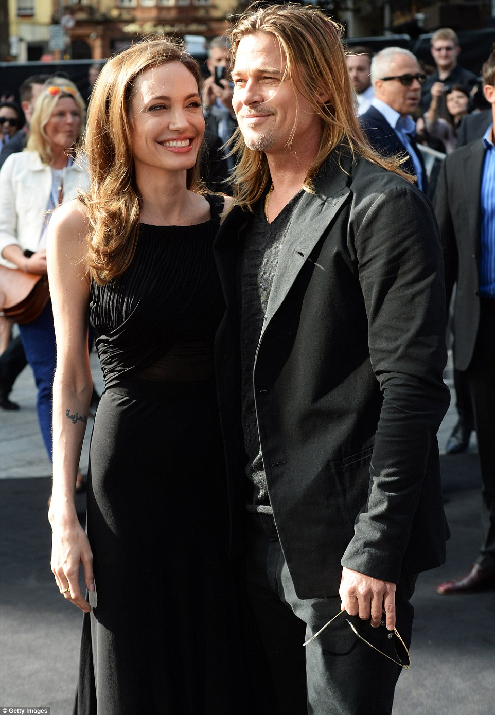 By her side: Brad is pictured with Angelina in June 2013, a month after she bravely penned an op-ed about undergoing a double mastectomy