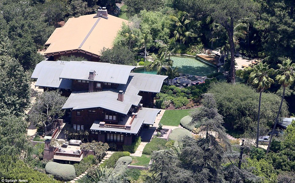 Main pad: When in the US, the family spends most of their time in the Los Feliz home that Pitt bought in 1994 and where he once lived with Aniston (above)