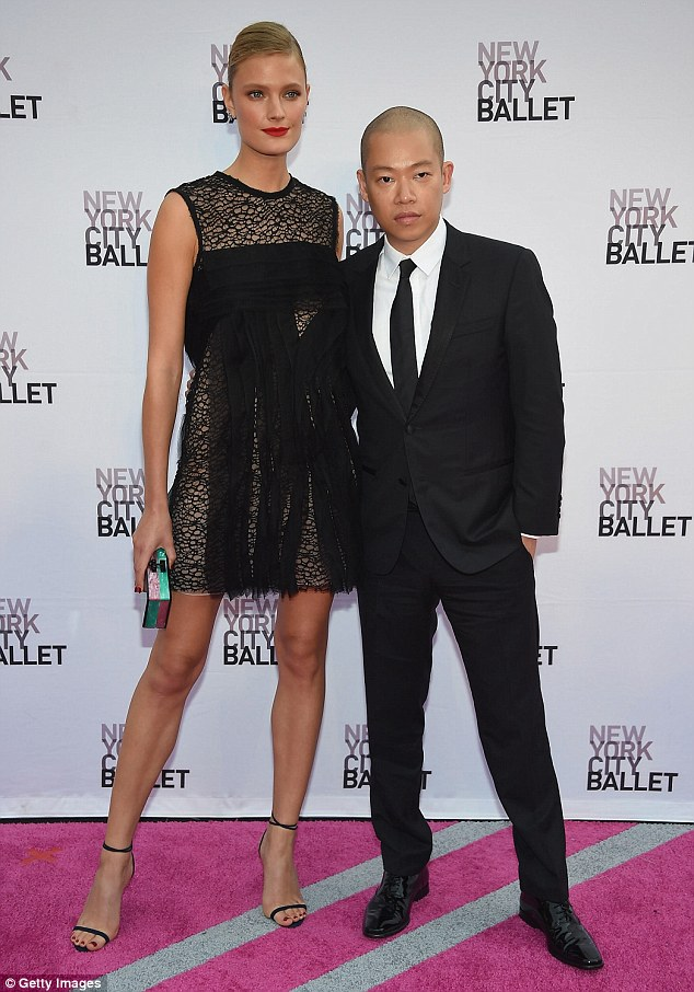 Designs on you: The leggy model posed for pictures with designer Jason Wu