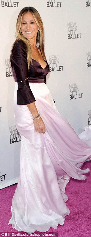 Carrie-d away: The 51-year-old actress enjoyed swishing her silky long skirt this way and that way as she made her way down the purple carpet