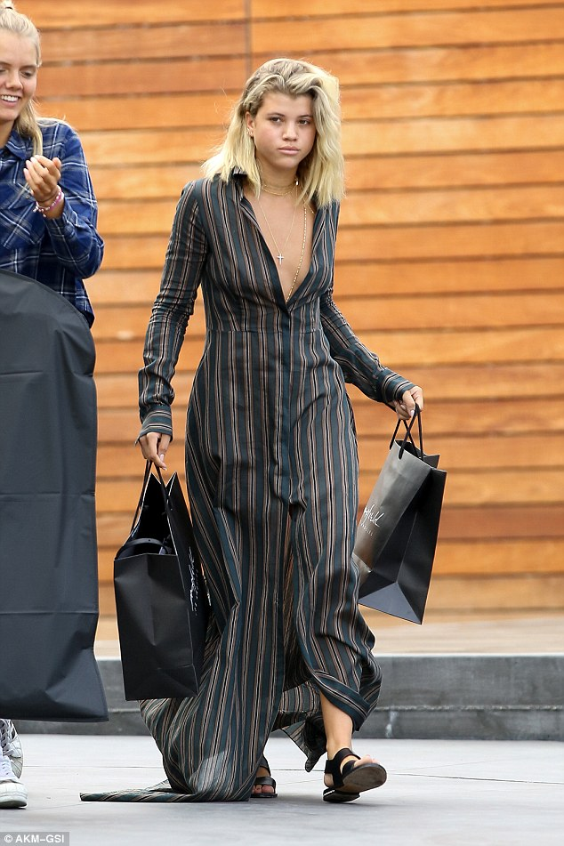 Retail therapy! The model was seen emerging from high-end store Maxfield in West Hollywood with multiple purchases in her grasp