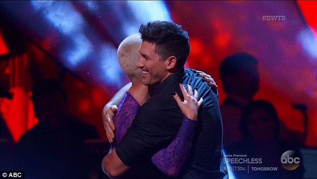 Hugs: Maksim raised a smile while Amber let the news sink in
