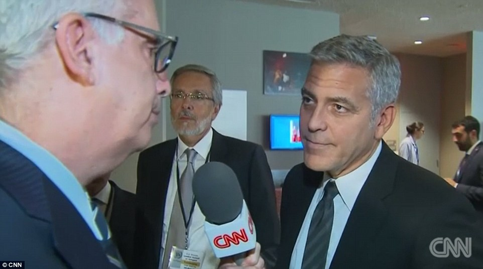 Breaking the news: CNN'sRichard Roth had the delicate task of informing George Clooney of his friends' split while Clooney wasworking with President Obama at the United Nations to solve the global refugee crisis