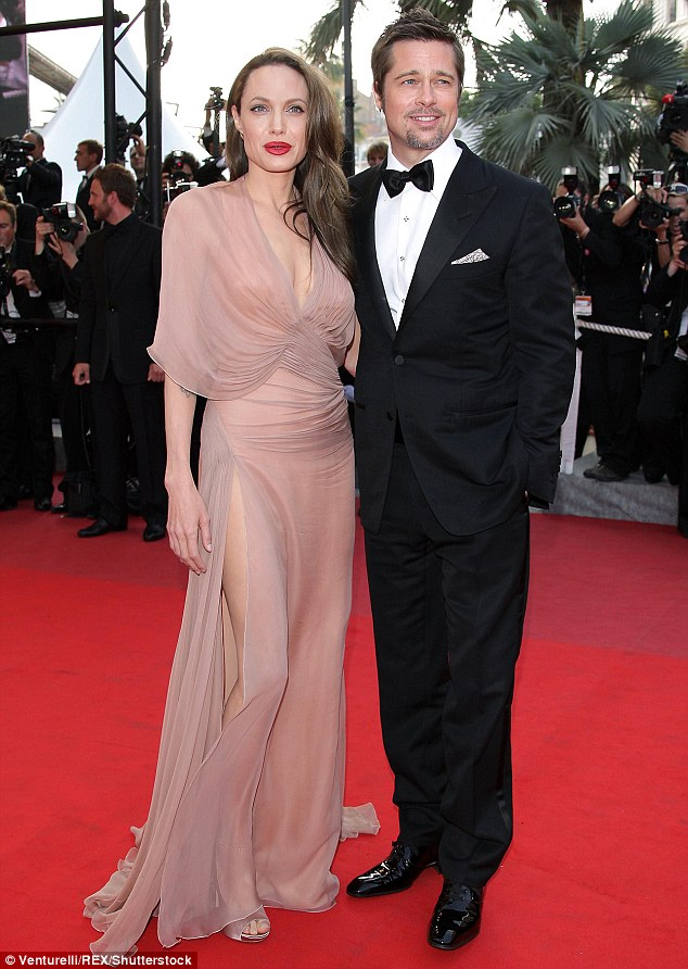 It's over: Angelina reportedly filed the divorce papers on Monday, nearly blindsiding Brad with the decision