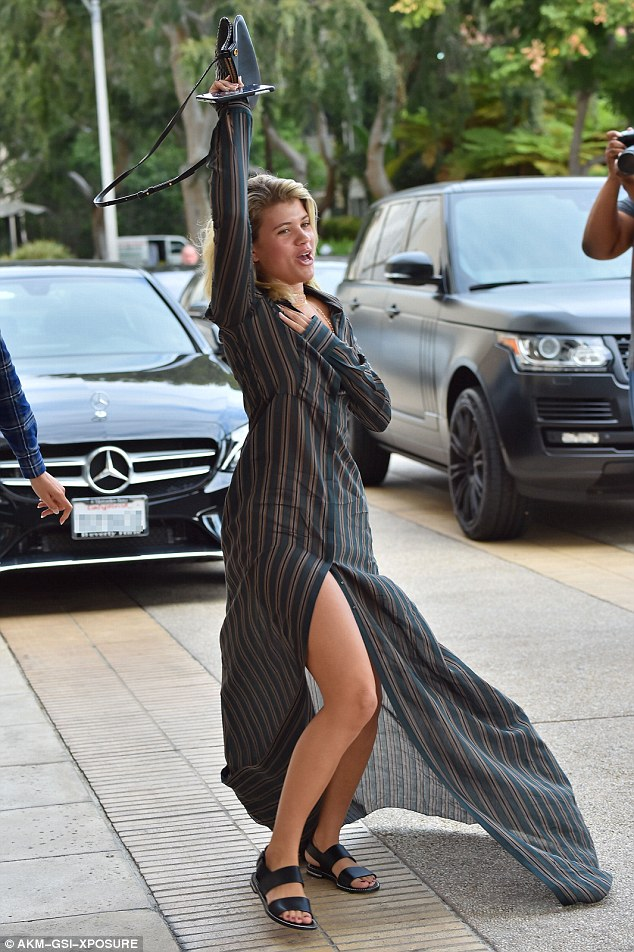 Leggy display: The high slit in the front of the dress blew open in the wind showing off Sofia's lean pins