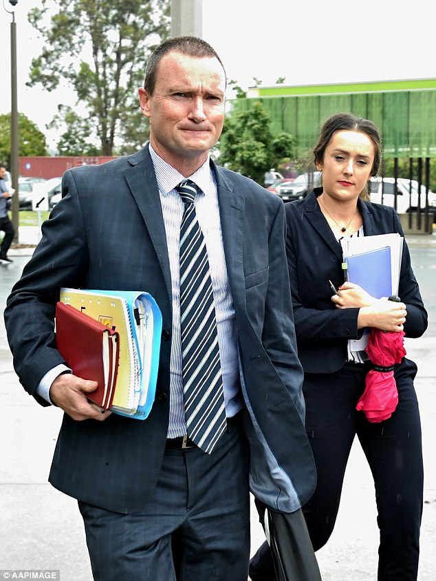 Trent Thorburn's lawyer John Ide (left) leaves the Southern Districts Magistrates Court in Beenleigh on Wednesday