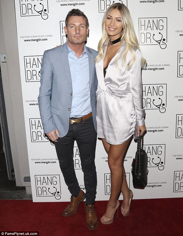 All loved up: Dean Gaffney looked anything but a mess on Tuesday night as he attended the Hang Dr. party in Soho,London with his model girlfriend Rebekah Ward