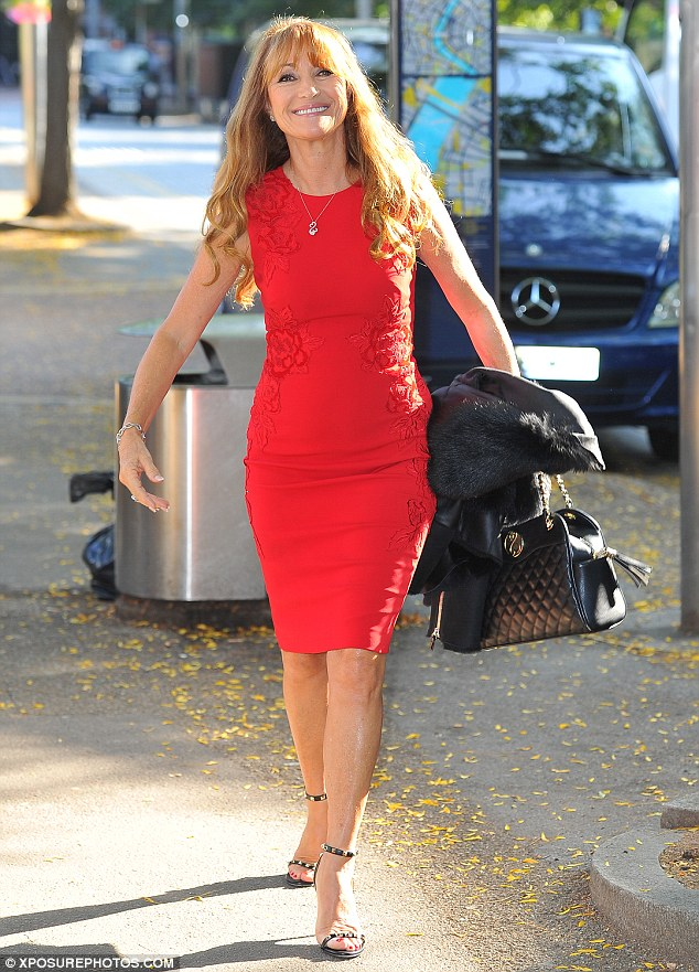 Lady in red: Jane Seymour dazzled in a striking scarlet dress as she made a glamorous arrival at the ITV studios in central London on Wednesday ahead of her appearance on This Morning