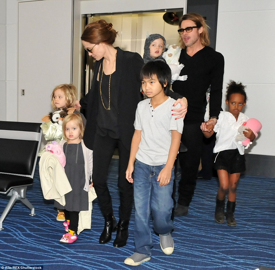 The actress filed papers citing irreconcilable differences as the reason for the split and asked for physical custody of the couple's six children - Maddox, age 15; Pax, aged 12; Zahara, aged 11; Shiloh, aged 10; and twins Vivienne and Knox, aged eight. The family is pictured at Tokyo airport in 2011
