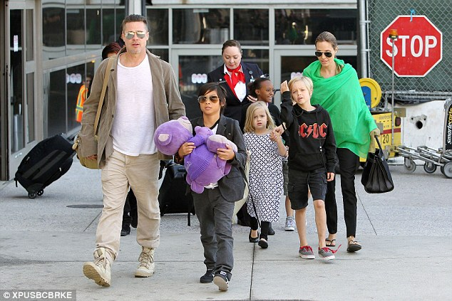 A source claimed Jolie became jealous of the children's nanny (not pictured). The family are seen here together at LAX airport