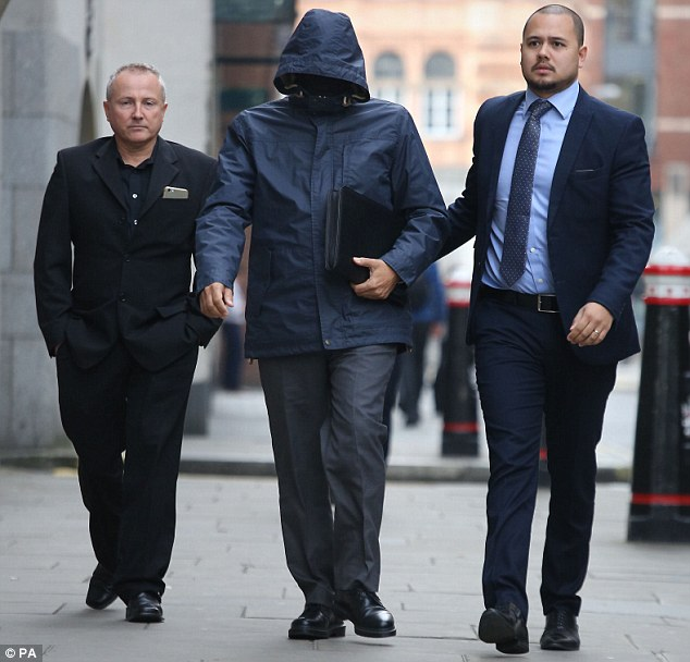 Arrival: Mahmood (centre), who was known as the 'Fake Sheikh', arrives at the Old Bailey in London this morning where he is accused of conspiring to pervert the course of justice