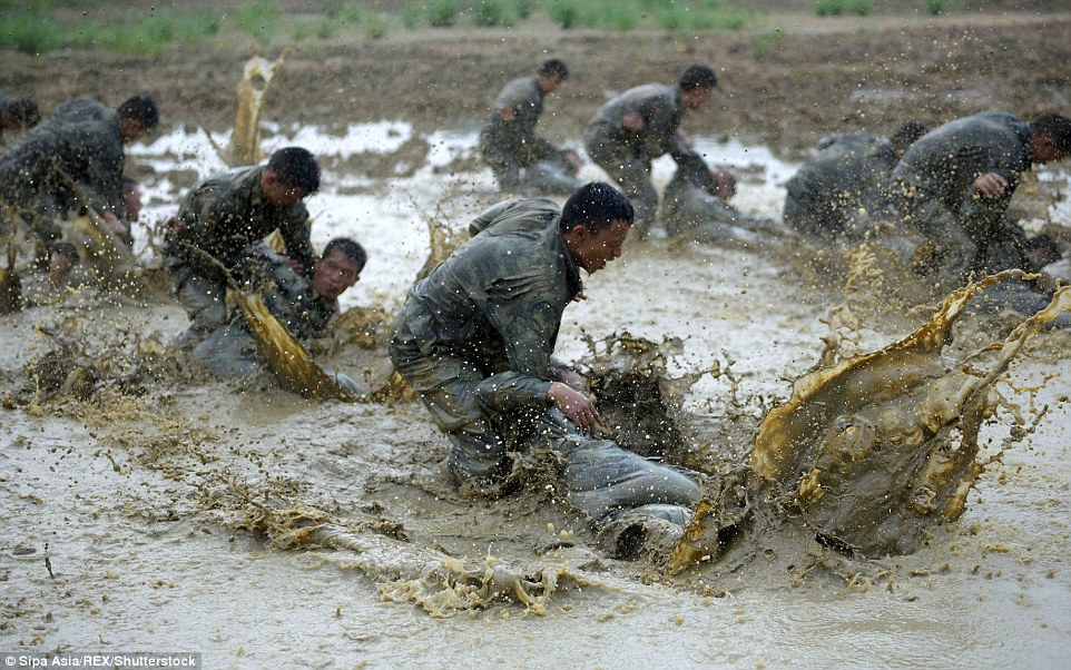 Going to need a shower! Police undergo training in treacherous conditions in Nanning, Guangxi Autonomous Region