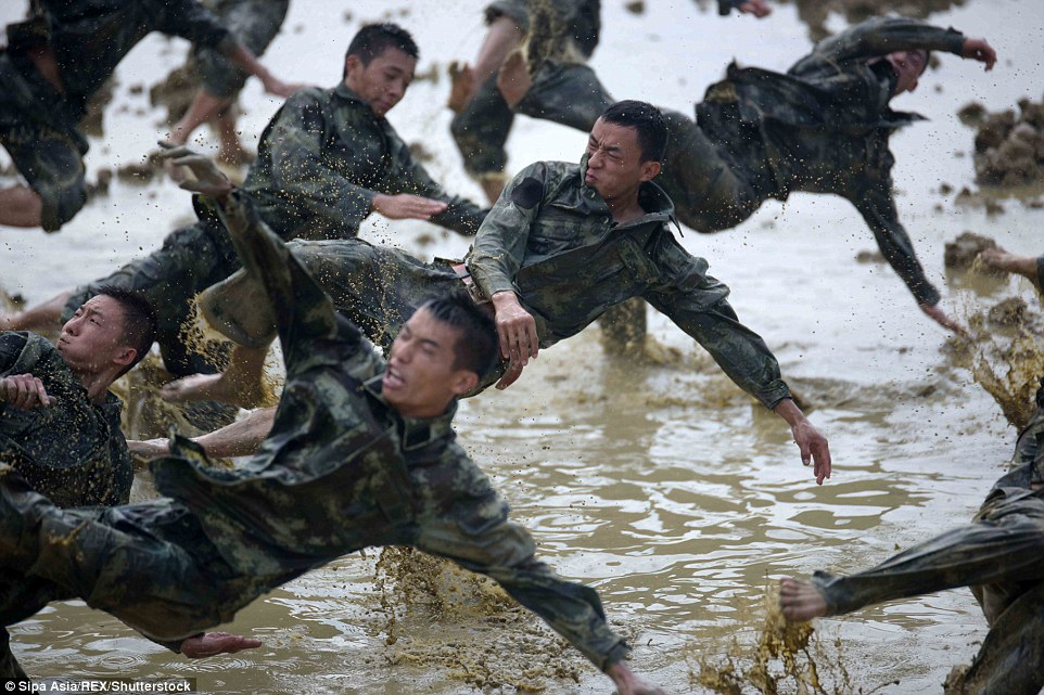 Jumping around in the mud: Police undergo training in treacherous conditions in Nanning, Guangxi Autonomous Region