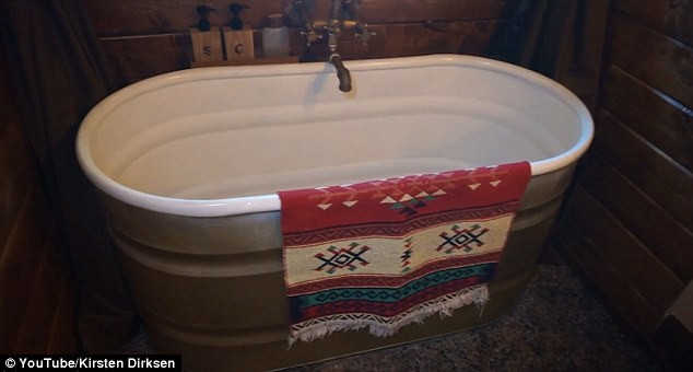 The house may not have a kitchen but it has a delightful deep free-standing bath