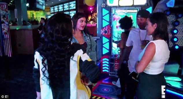 Family meeting:While it does not look the most natural thing in the world, Kylie and Chyna embrace as Tyga stands sipping his drink and looking on