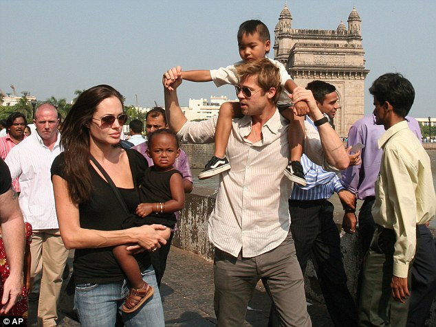 She swanned around the globe collecting children, here they are a decade ago in Mumbai with the first two
