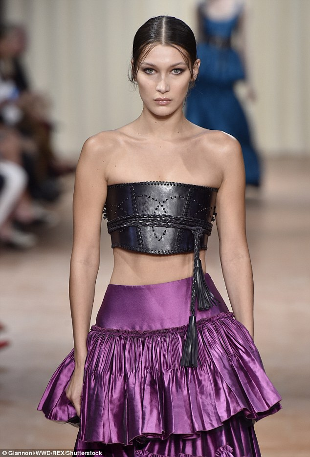 Bell for leather!For her first chic look, Bella showed off her toned abs and gym-honed arms in a leather bandeau top which was fastened with a rope and tassle