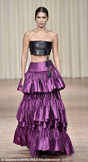 Ruffled and ready:Adding to the glamour, she donned a purple satin skirt with layers of ruffles, that skimmed over her hourglass figure whilst her raven coloured locks were slicked away