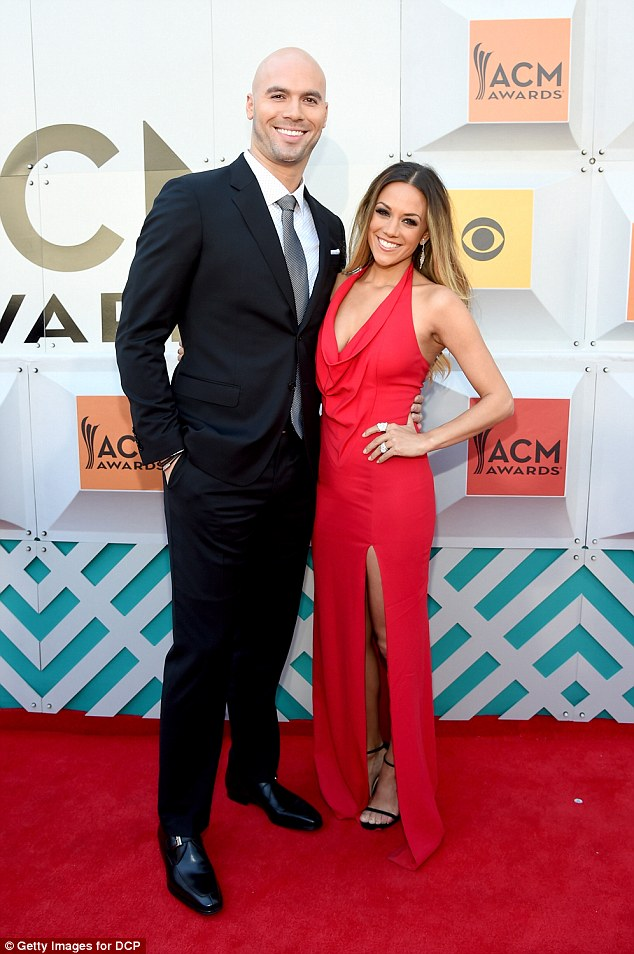 Hard to hear:A dramatic new report claims Jana Kramer's estranged husband Mike Caussin cheated on her before and during their marriage (both pictured in April in Las Vegas)