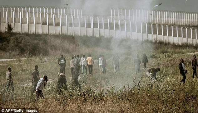 Tear gas was used to keep migrants away from the temporary barrier which keeps them away from lorries heading into the port