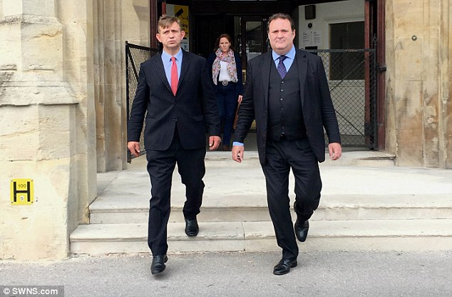 eter Mark Doggrell (left) leaving Taunton Crown Court with his solicitor Jamie Foster (right)