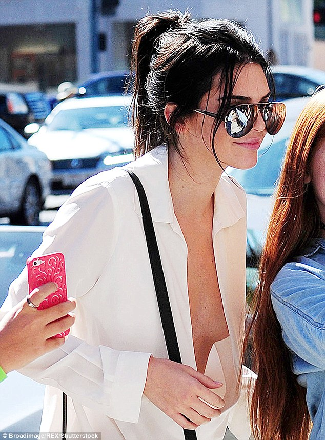 No bra, and no top either! Jenner loves to wear as little as possible as evidenced here in July