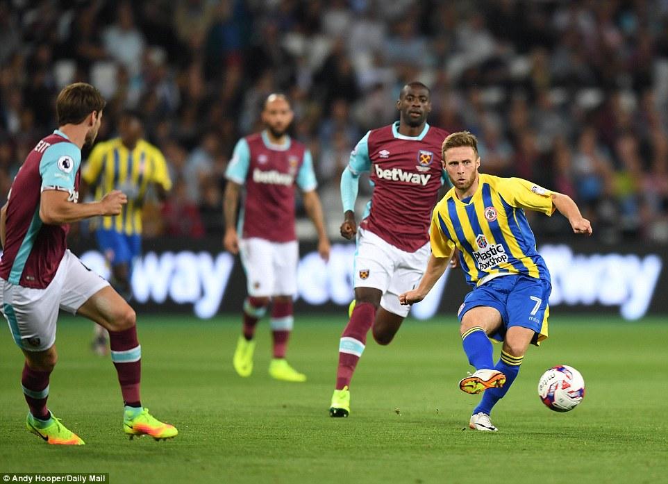 Jordan Clark makes a forward pass as Accrington apply some early pressure to their Premier League hosts