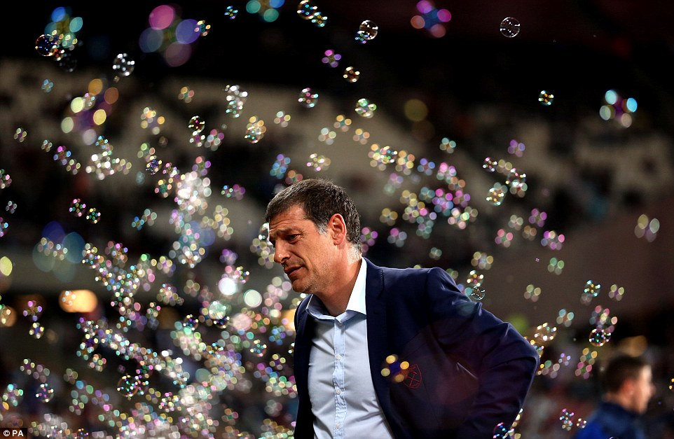 West Ham boss Slaven Bilic knows the pressure is on as bubbles float around the dugout before kick-off against Accrington
