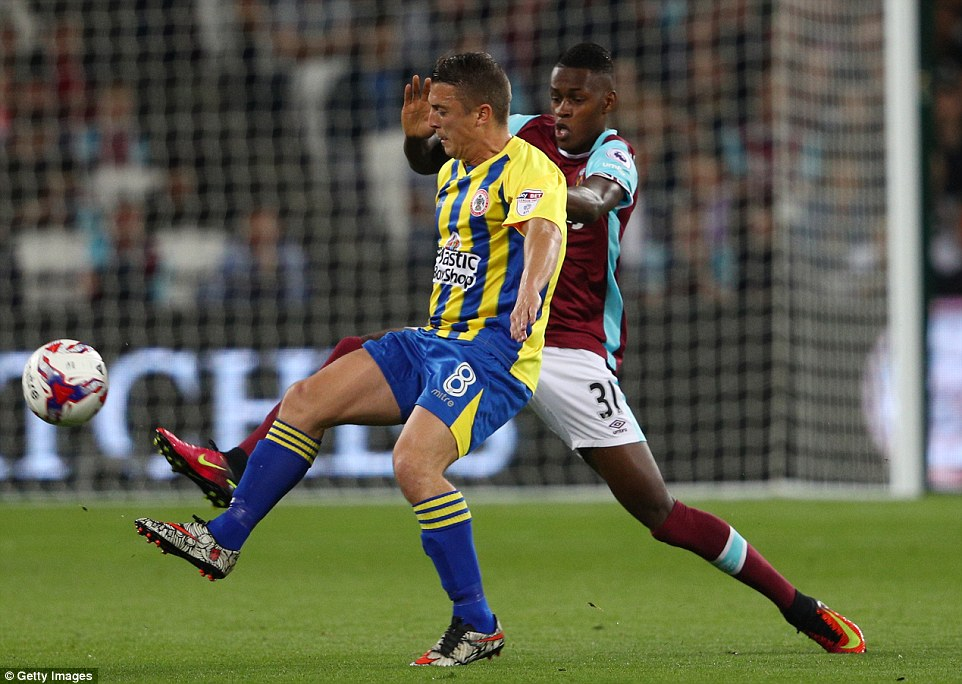 West Ham's Edmilson Fernandes applies the squeeze to Accrington'sScott Brown during the first half of their EFL Cup tie
