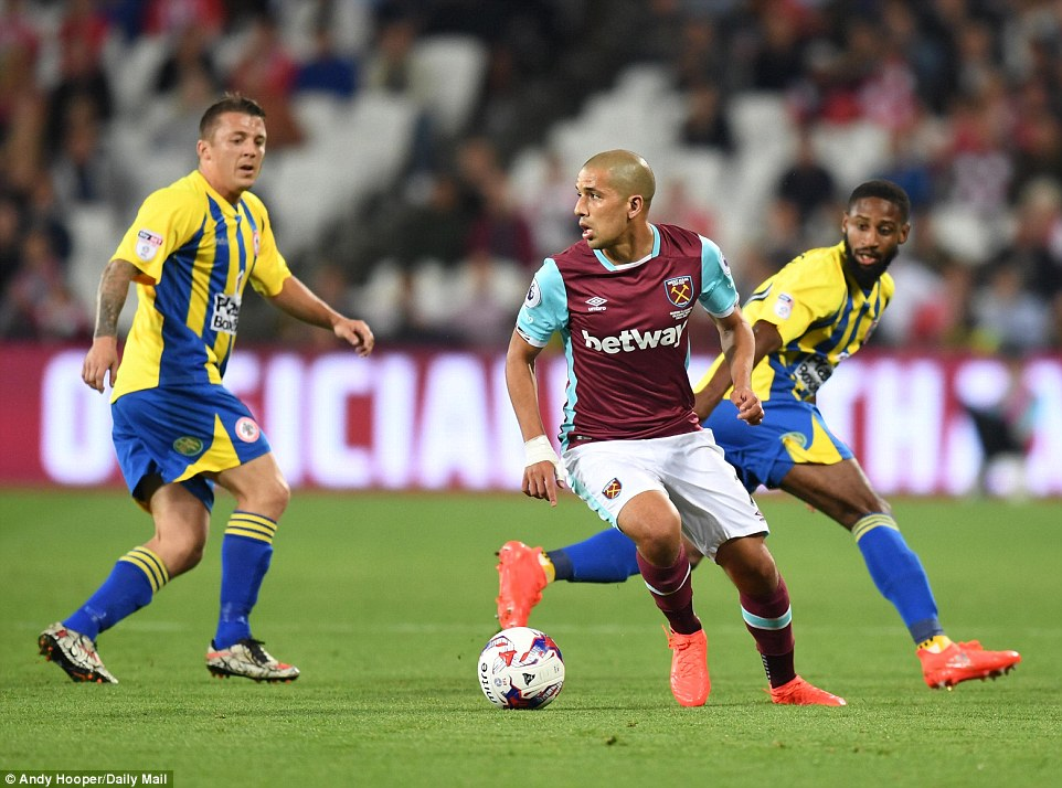 Sofiane Feghouli turns away from the attention of two Accrington players as he tries to get West Ham going forward