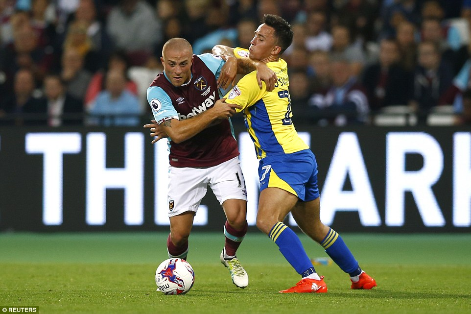 West Ham's Turkish winger Gokhan Tore gets into a grappling match with Stanley'sJohn O'Sullivan near the touchline
