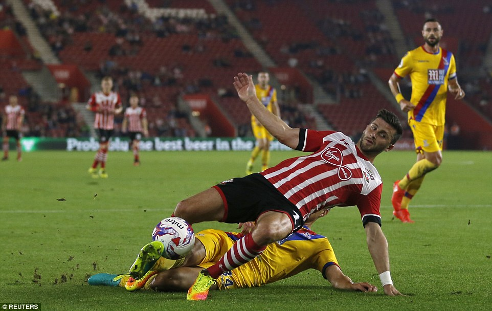 Long takes a tumble following Kelly's challenge and the home side are awarded a penalty at St Mary's