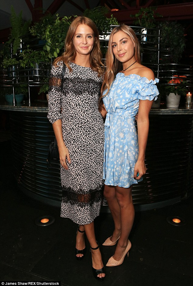 Leggy ladies: Millie attended the event with her friend Lily Frieda, who looked ravishing in a knee-length blue dress