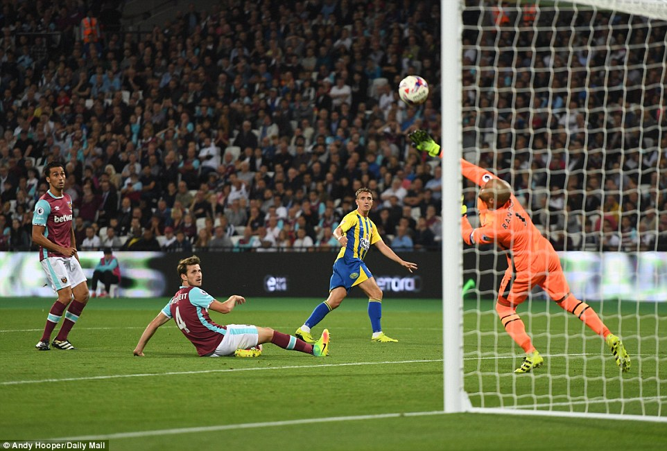 West Ham stopper Darren Randolph gets his hand to Sean McConville's effort as the ball hits the post and goes clear