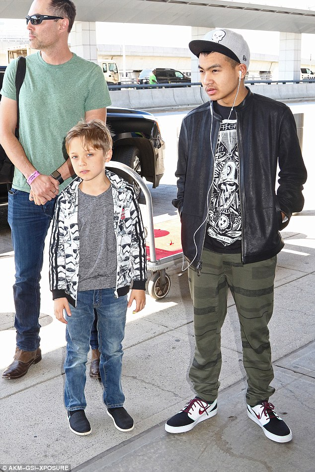 Nanny duties: In June, Haven was seen at JFK Airport in new York with his famous sister and Knox, as well as Maddox, 15, whom Jolie adopted from Cambodia before she met Pitt