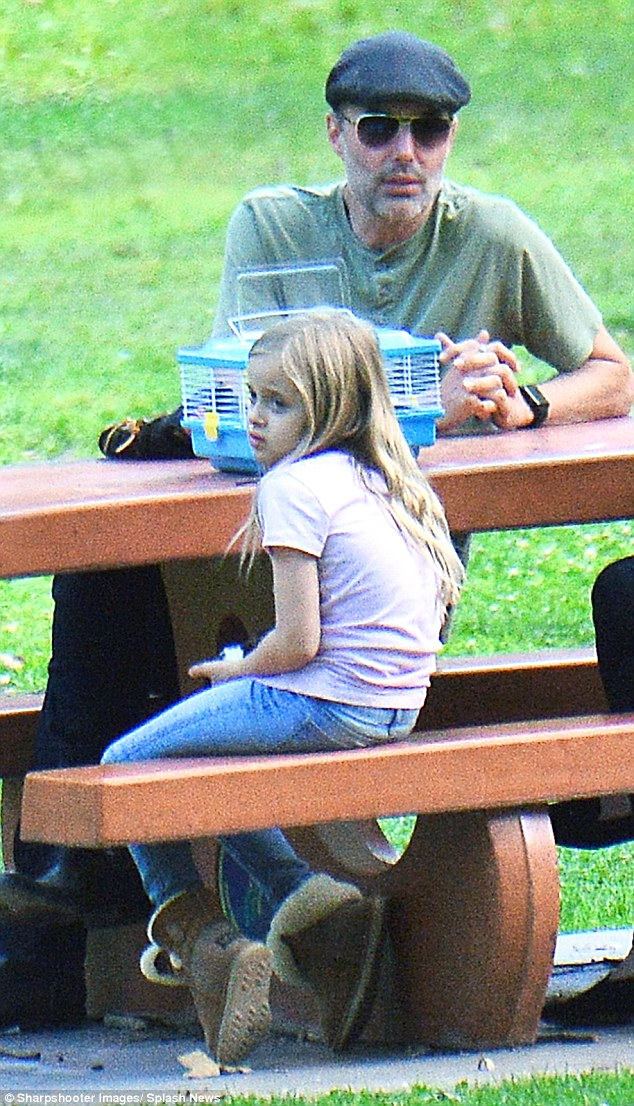 With her uncle: Knox's twin Vivienne also joined in the outing and appeared to have brought along a pet in a carrier as she sat at a picnic table with Haven