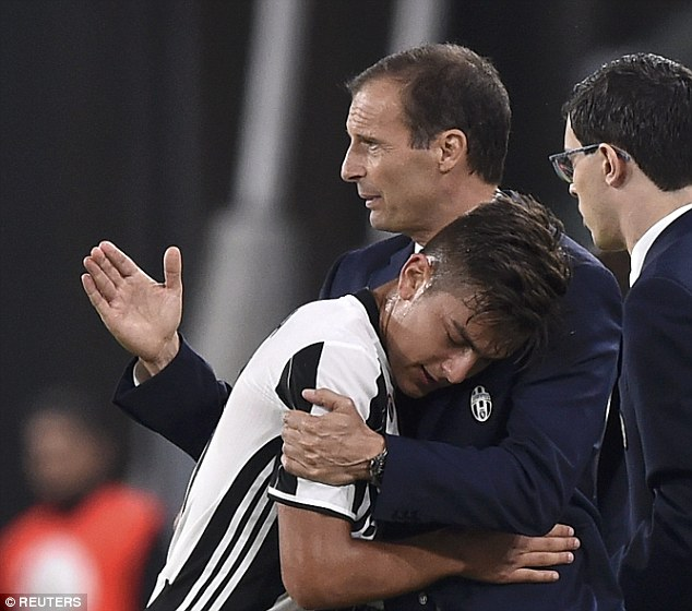 Allegri celebrated with Paulo Dybala (left) and the rest of his squad at full-time