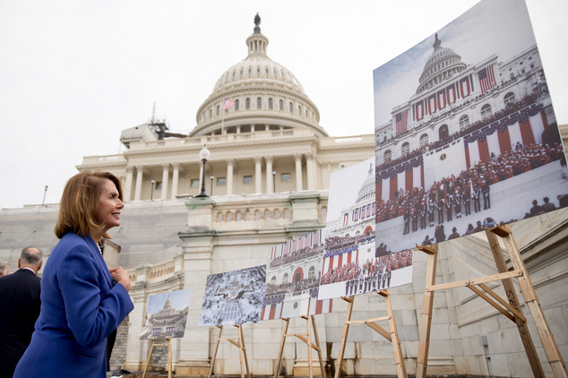 House Minority Leader Nancy Pelosi of Calif. look at photographs of former inaugurations on display on Capitol in Washington, Wednesday, Sept. 21, 2016, duri...