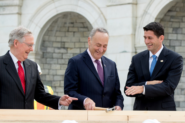 House Speaker Paul Ryan of Wis., right, and Senate Majority Leader Mitch McConnell of Ky., left, laugh at Sen. Charles Schumer, D-N.Y. bends his nail during ...