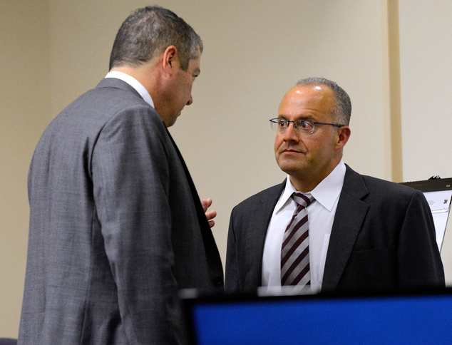 Defense attorneys Sam Bregman, left, and Luis Robles talk during a break during the trial of two former Albuquerque officers, defendants Keith Sandy and Domi...