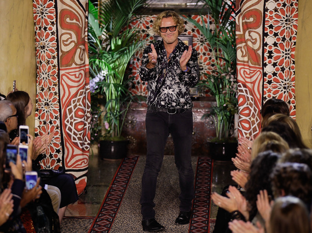 Fashion designer Peter Dundas acknowledges the applause of the audience after presenting the Roberto Cavalli women's Spring-Summer 2017 collection,  in Milan...