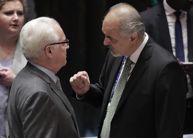 Syria's permanent representative to the United Nations, Bashar Ja'afari, right, talks with Russia's U.N. Ambassador Vitaly Churkin before the start of a Secu...