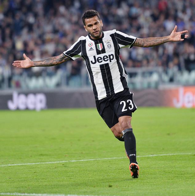 Juventus's Dani Alves celebrates after scoring a goal during the Serie A soccer match between Juventus and Cagliari at the Juventus Stadium in Turin, Italy, ...