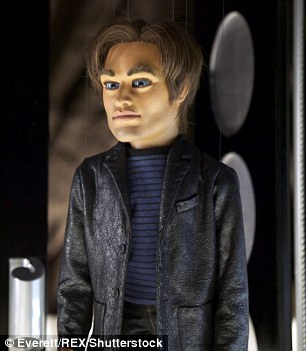 Strangely similar: Both Sam and his puppet counterpart share deep-set blue eyes and a prominent jawline