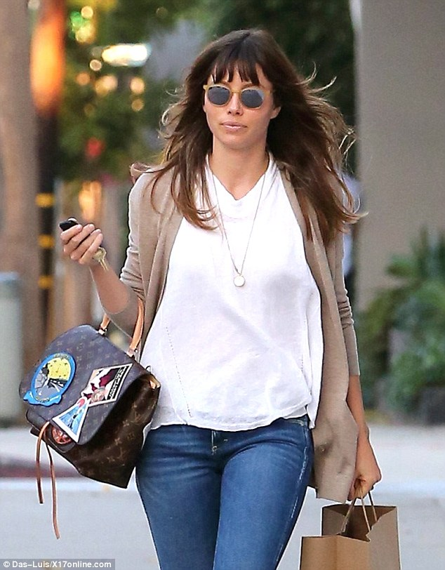 Pricey purse! Jessica Biel flashed an expensive handbag - which retails for around $4,000 dollars - as she stylishly stepped out in Los Angeles on Wednesday