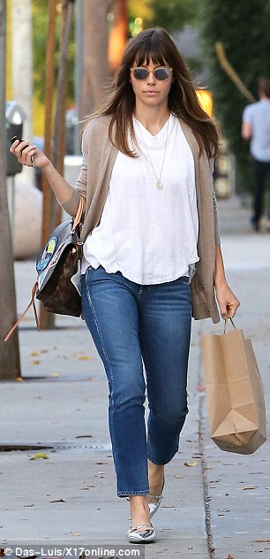 Effortlessly polished: The 34-year-old actress and mother-of-one dressed casually chic in a white T-shirt, blue jeans, and silver metallic flats
