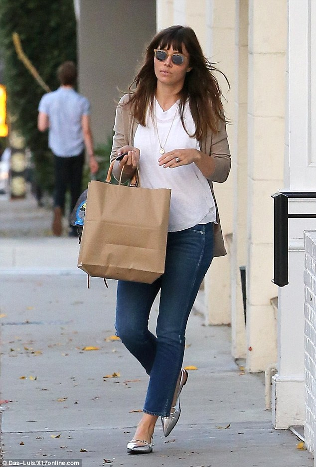 Details: The brunette beauty - who married Justin Timberlake in 2012 - wore her wedding ring on her left ring finger and also added a long gold necklace to her relaxed look