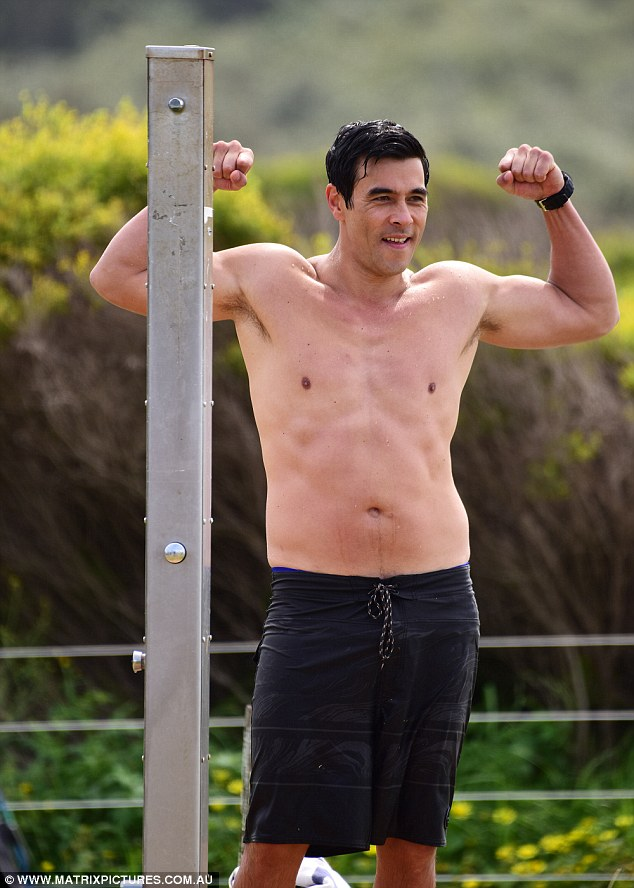Flex: James Stewart showed off his ripped body as he flexed on set of Home and Away  in Palm Beach on Tuesday