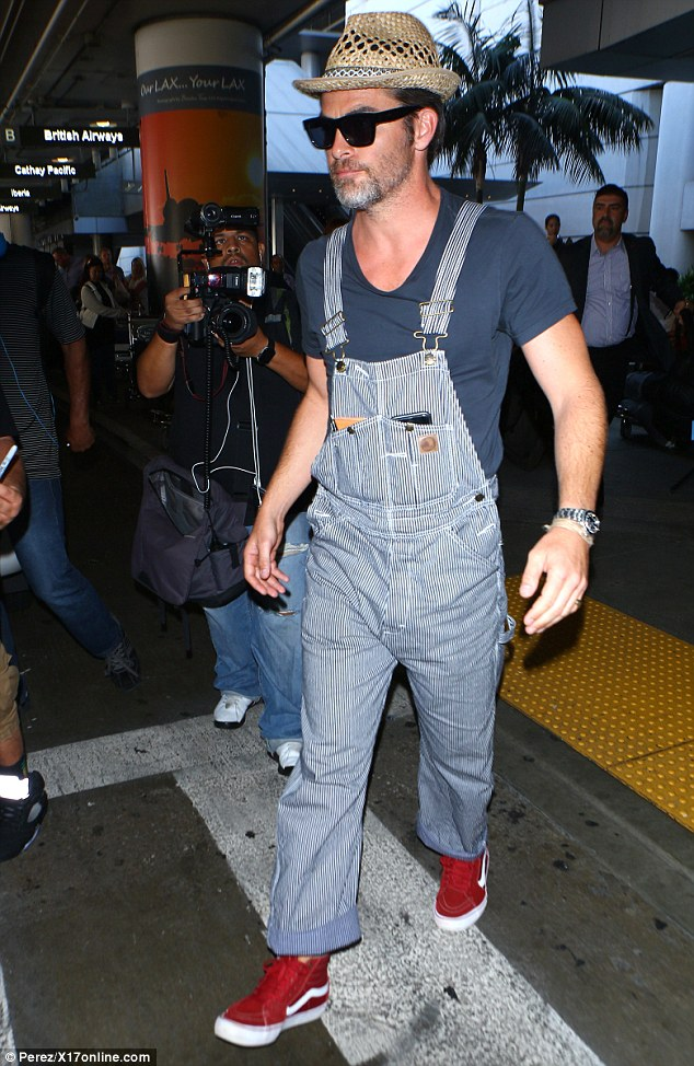 Switching styles: The 36-year-old dashing star dismissed his character's clean-cut image and pristine wardrobe for a pair of dungarees teamed with a straw hat and a peppered beard